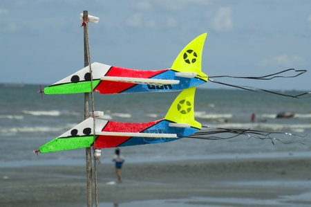 colorful toy plane at the beach photo