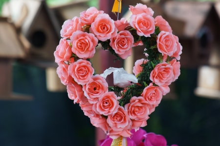 bouquet of artificial rose flower,heart shape  photo