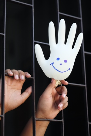 hand in jail showing smiling glove  photo