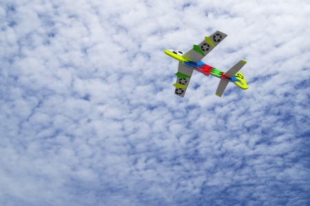 colorful toy plane against blue sky. photo