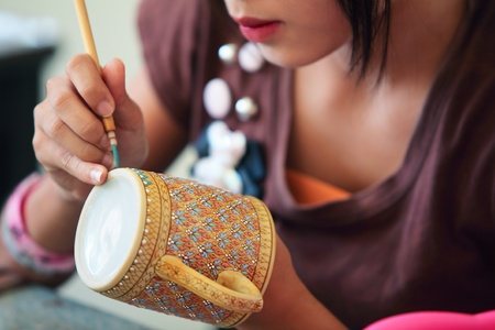 women painting on thai ceramic benjarong   photo