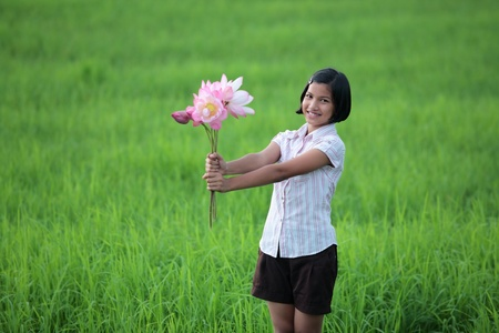 girl posing by  give lotus flower  photo