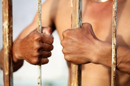 prisoner of war: prisoner in jail