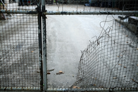 prison system: escape from wire mesh fence
