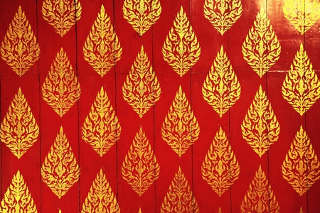 thai style painting on red wall photo