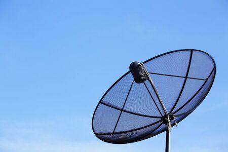 satellite dish against blue sky  photo