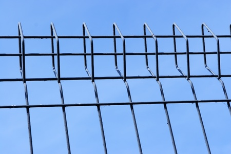 metal fence over blue sky  photo