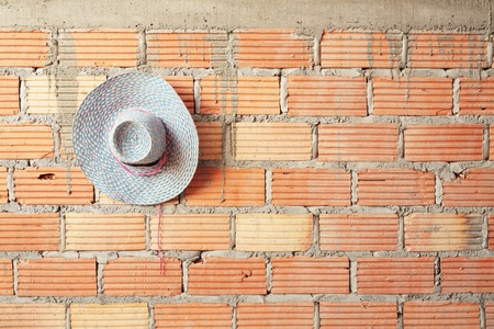hat on brick wall  photo