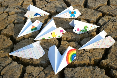colorful paper airplane on ground  photo