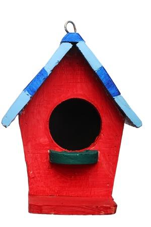 colorful bird house isolated on white background  photo