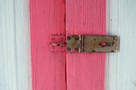 hasp: colorful wooden door with grunge padlock hasp