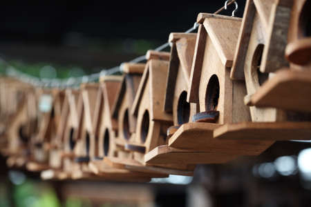 row of wooden bird house  photo