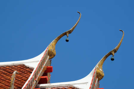 Gable apex in temple roof with blue sky background photo