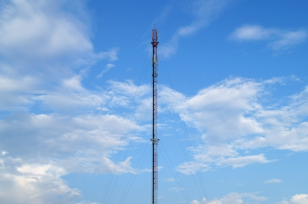 cell phone tower against blue sky  photo