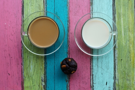 milk,coffee and cupcake on colorful background. photo