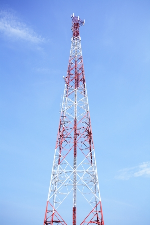 Red and white tower of communications with their telecommunications antenna  photo