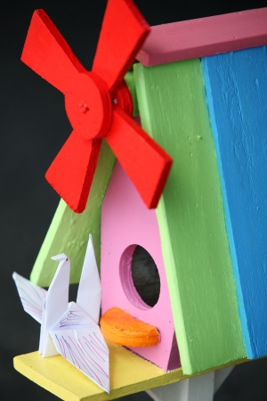 origami bird and colorful bird house  photo