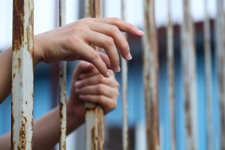 incarceration: hand in jail