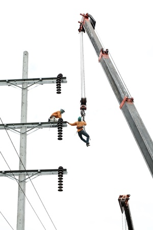 man working on electricity post