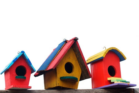 colorful bird house isolated on white background  photo