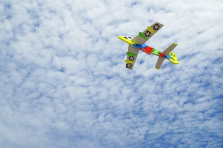 colorful toy plane on blue sky  photo