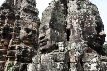 Faces of King Yayavarmann VII on the beautiful Bayon temple, Angkor Wat, Cambodia photo