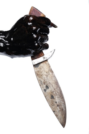 black hand holding knife isolated on white background  photo