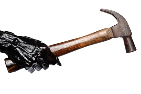 black hand holding hammer isolated on white background  photo