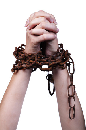 hand imprison by rusty chain isolated on white background