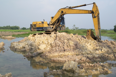 back hoe: Large Yellow Back Hoe at site Stock Photo