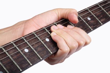 fret: hand holding guitar fret isolated on white background. Stock Photo