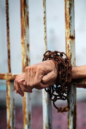 hand in jail  Stock Photo - 25443267