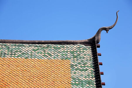 temple roof with blue sky. photo
