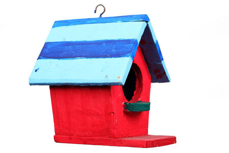 colorful bird house isolated on white background. photo