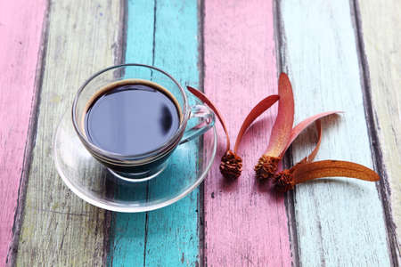 coffee cup on colorful wooden panel photo