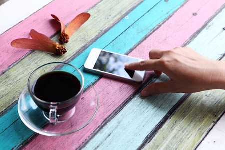 smart phone and coffee cup on colorful desk photo