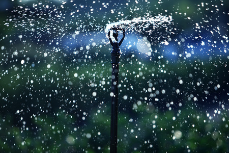 sprinkling: water sprinkler as abstract background Stock Photo