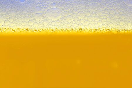 close-up of a yellow color beer into the glass photo