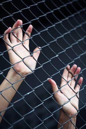 prisoner hand in jail photo