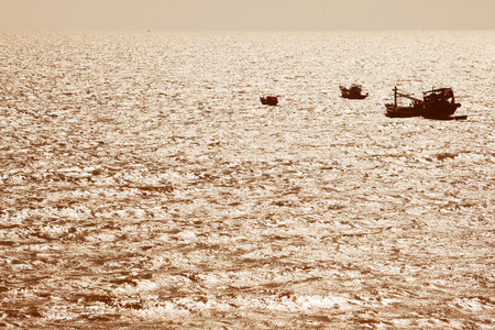 sillouette: sillouette of tradition fishery ship in muine bay,vietnam Stock Photo