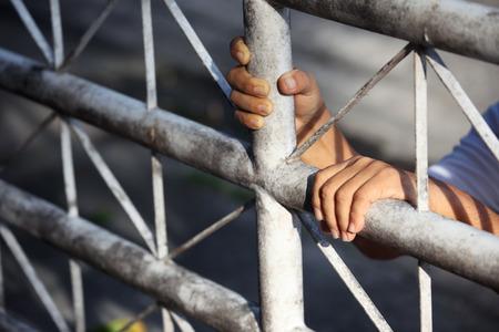 man in jail: hand in jail