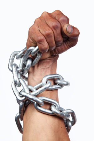 constraints: hand with chain isolated on white background. Stock Photo