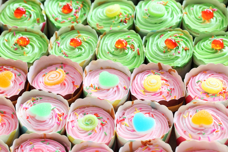 colorful cup cake background. Stock Photo