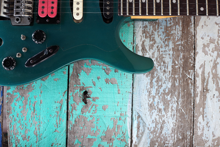 humbucker: colorful guitar with grunge wooden panel background.
