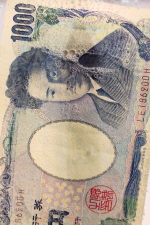 yen note: close up of yen note in water Stock Photo