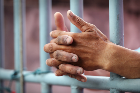 jail cell: hand in jail