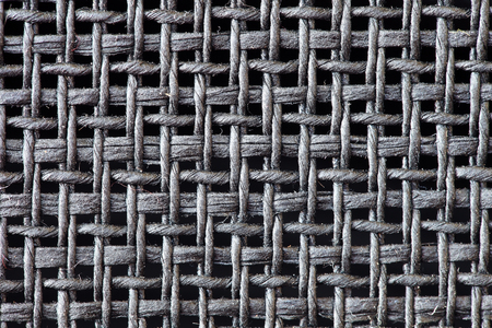 synthetic fiber: black weaver texture background.