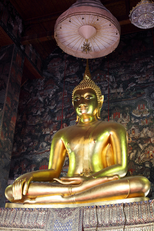 thai painting: golden buddha statue with thai painting background
