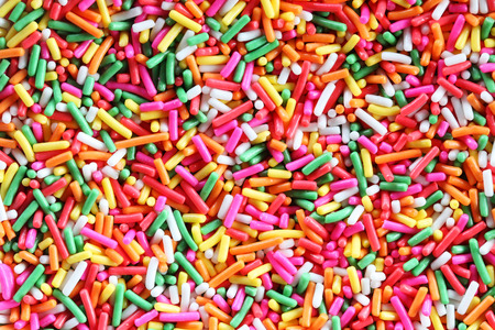 sprinkle: colorful sugar sprinkle background. Stock Photo