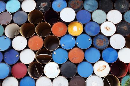 brent: rusty oil barrels background.